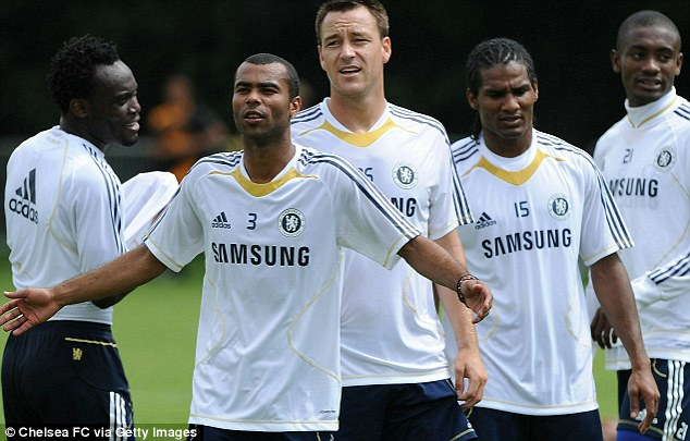 Happier times: Malouda (second from right) trains with his Chelsea team-mates