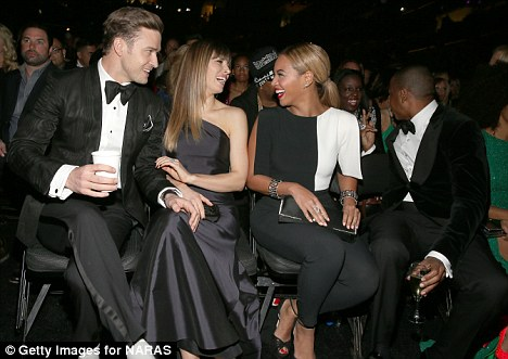 Old married men: Jay-Z and Justin sat front row at the Staples Center with their wives Beyonce and Jessica Biel