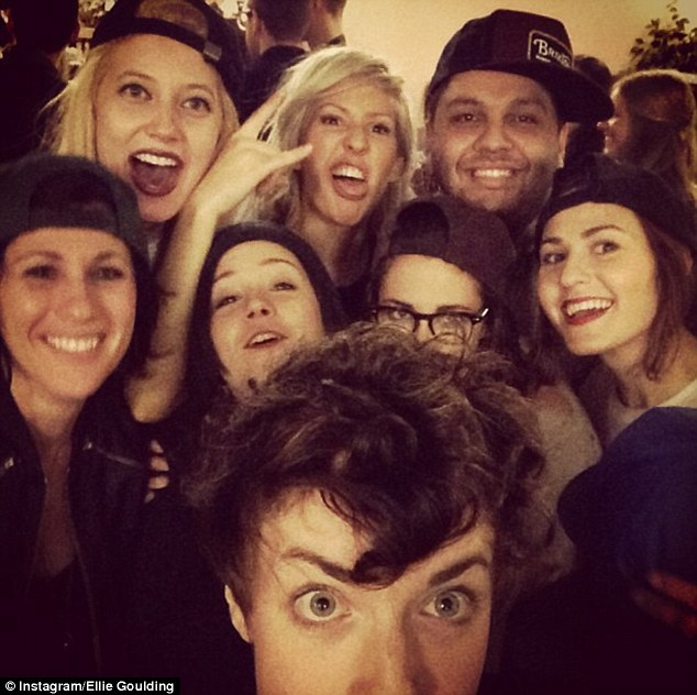 Party time: Kristen Stewart was pictured in the centre of Ellie Goulding and a group of pals as they partied backstage following the singer's Los Angeles gig