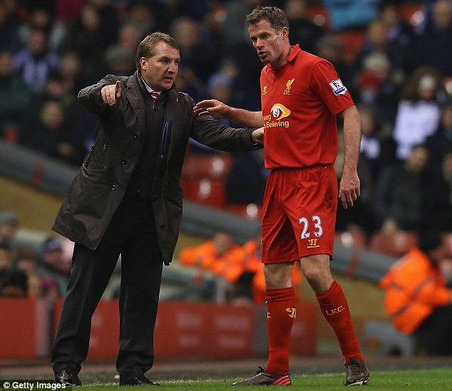 Listen here, Jamie: Liverpool manager Brendan Rodgers issues instructions to veteran defender Jamie Carragher during Monday night's defeat by West Brom