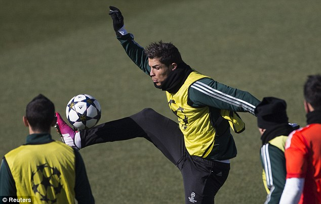 Preparations: Cristiano Ronaldo controls the ball during Real's training session on Tuesday morning