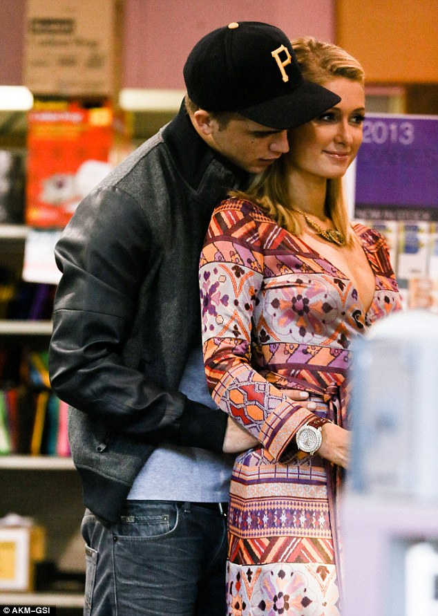 Not so private: Paris and River were spotted putting on a PDA as they hit the shops in LA a couple of days before, unfazed by who saw them