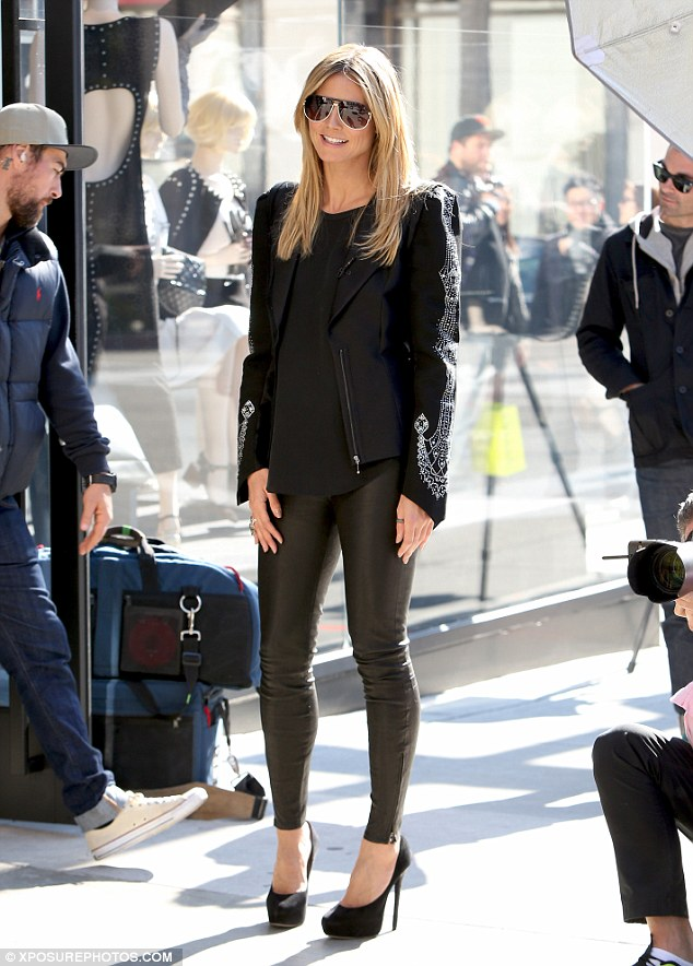 Show stopper: Heidi ensured all eyes were in her in a skintight pair of black leather trousers for the day on set