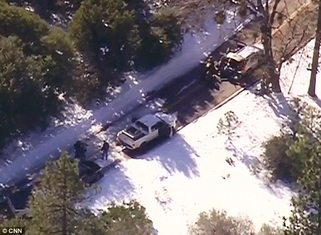 Gun battle: Dozens of heavily-armed officers are pouring into the region to surround the cabin where Dorner is pinned down