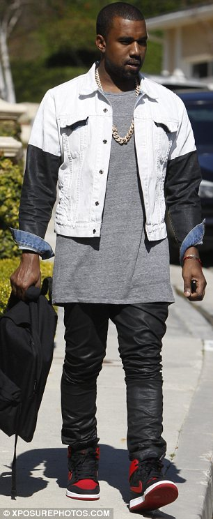Famous family: Kanye opted against changing from his flight earlier in the day while Kris was wearing very racy boots for the occasion