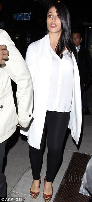 Dizzying heights: Lilit wore huge platform heels, teamed with black leggings, a billowing white blouse and long white cardigan