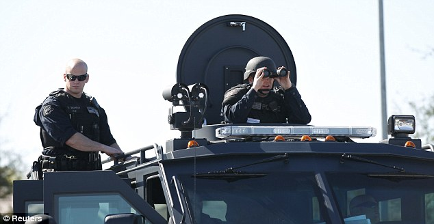 Tight security: Members of the Police SWAT team keep watch during the funeral service for Riverside Police Officer Michael Crain