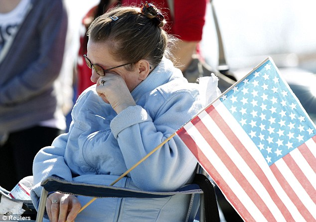 Mourning: Jennifer Corrigan wipes a tear during the funeral service for Officer Michael Crain who was ambushed by former policeman Christopher Dorner at a traffic light in Riverside, about 60 miles east of Los Angeles