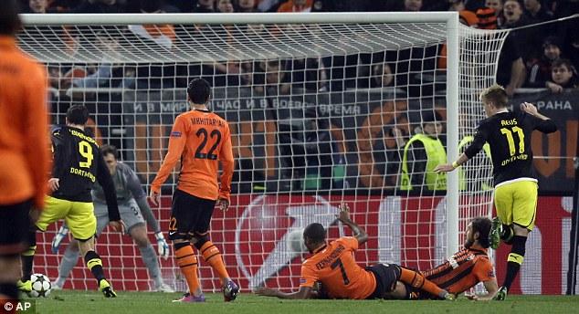 Equaliser: Robert Lewandowski pulls the trigger to level the score for Dortmund in Ukraine