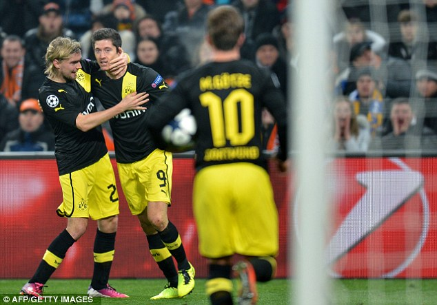 Crucial: Dortmund celebrate after grabbing a vital away goal against Shakhtar in the first leg