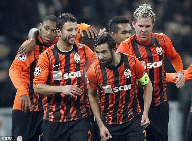 In front: Shakhtar celebrate after taking the lead against Borussia Dortmund in Ukraine