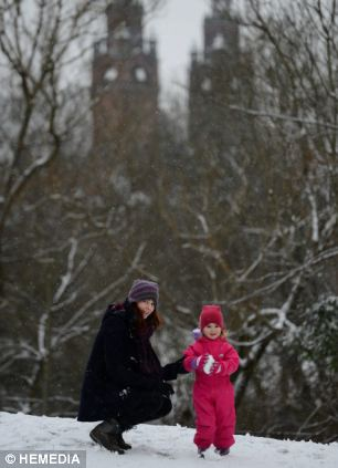 Rebecca Taylor Gibbs, two, from Glasgow, and mum Bethany Taylor, 26, play in the snow in Kelvingrove Park, Glasgow after a snow shower hit the city and the rest of Scotland