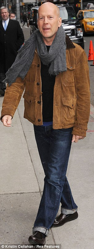 Cool and casual: Bruce looked great in a pair of indigo jeans and a suede bomber jacket
