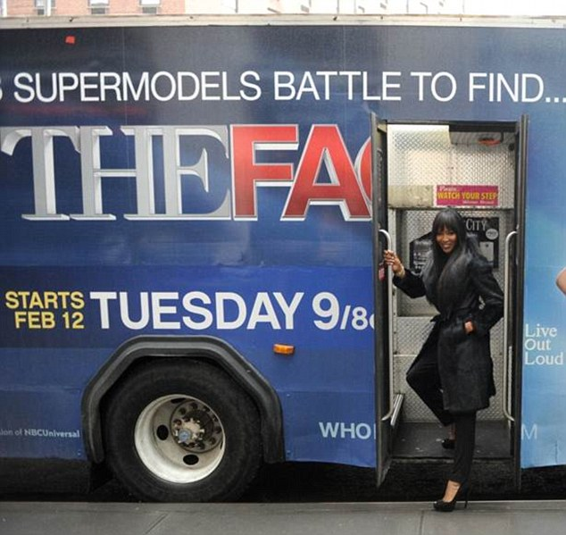 Jump on board: The supermodel even made the advertising bus look classy as she posed next to it