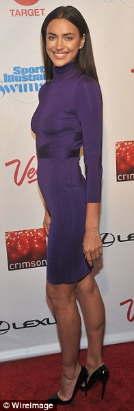 Pretty in purple: Irina Shayk looked incredible in a skintight berry coloured dress