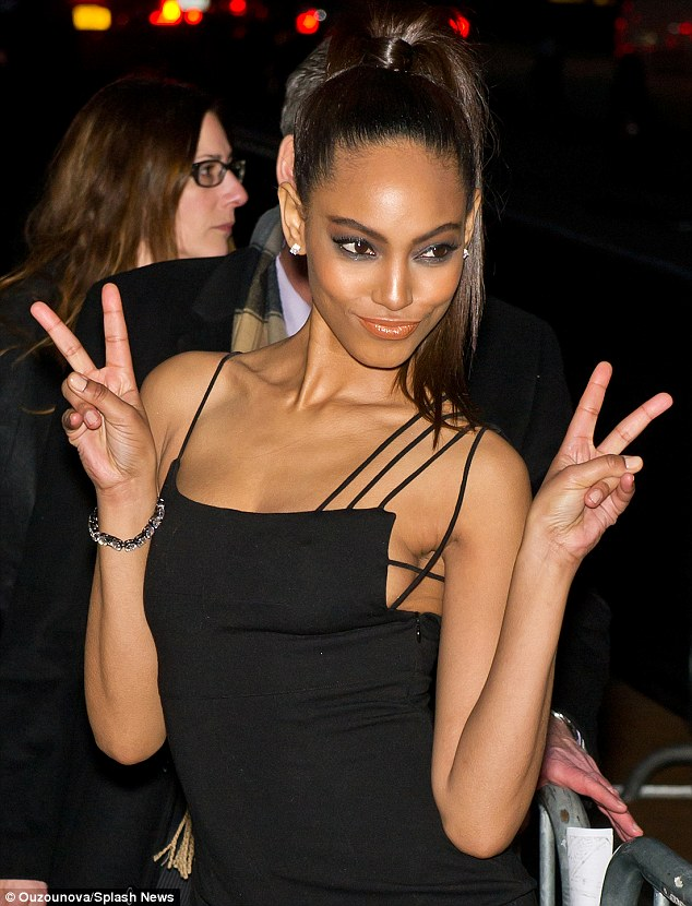 Peace out! Ariel Meredith gave a cheeky glance to photographers