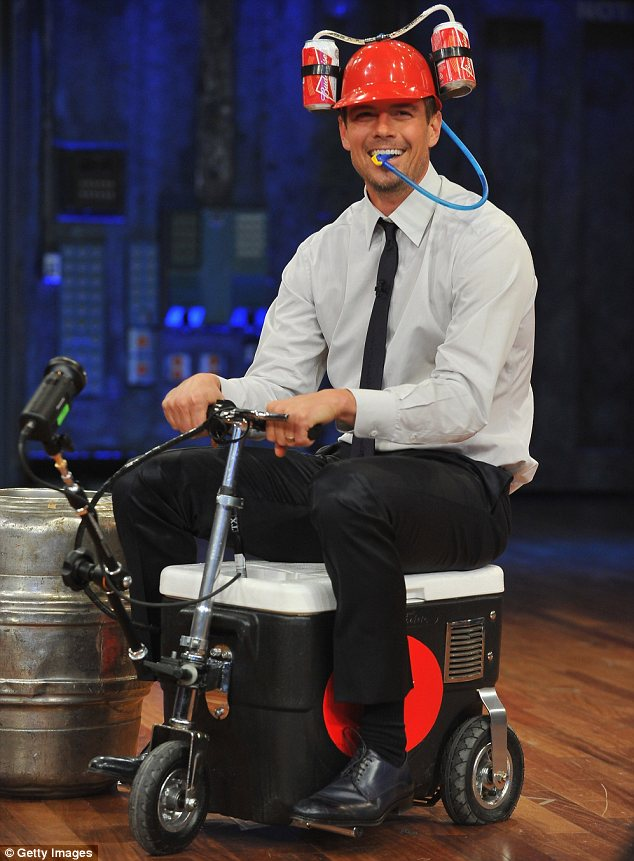 Not-so-hot wheels: Josh Duhamel played a game of Cooler Races when he appeared on Late Night with Jimmy Fallon on Tuesday