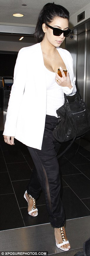 Adding some excitement: Kim's loose-fitting black trousers featured a sheer panel up the side