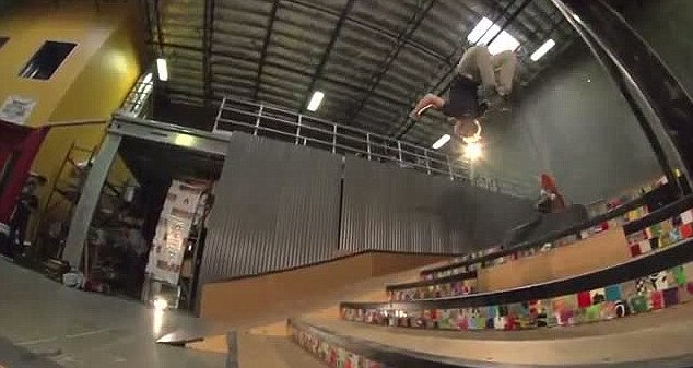 The skateboarder hangs in the air as he backflips down the stairs