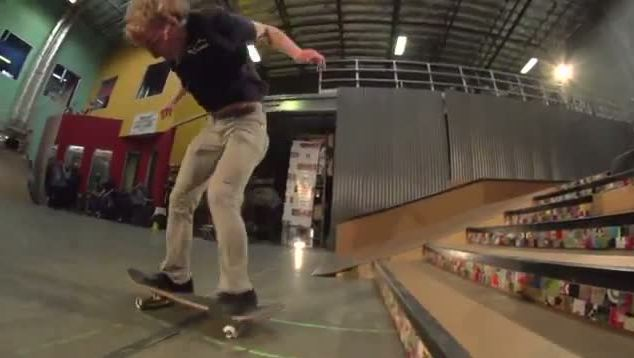 After backflipping in the air, Adam Miller then lands perfectly on the board at the bottom of the stairs