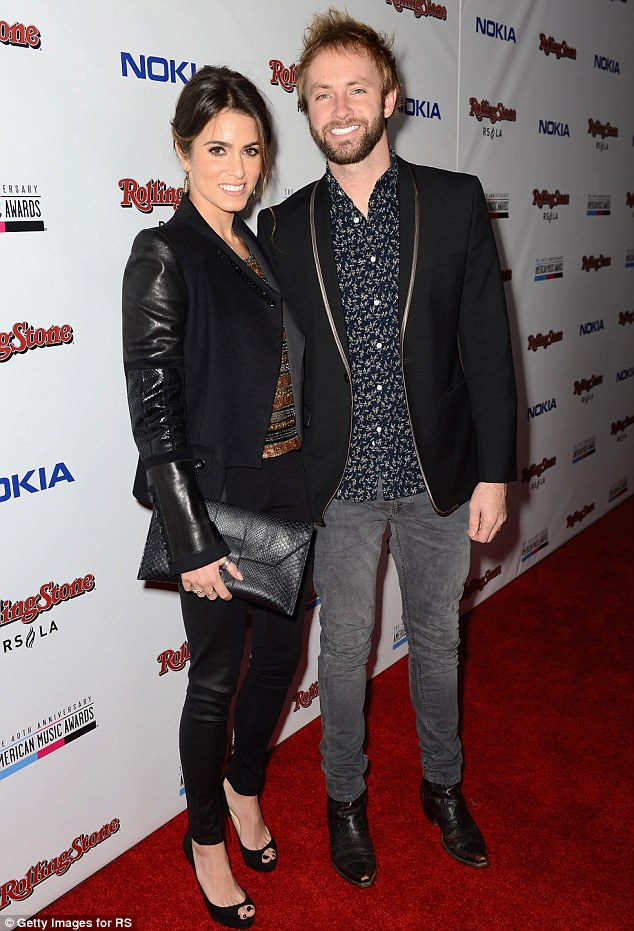 Happy: Nikki and Paul usually cut a much more preened and polished pair as they step out at red carpet events