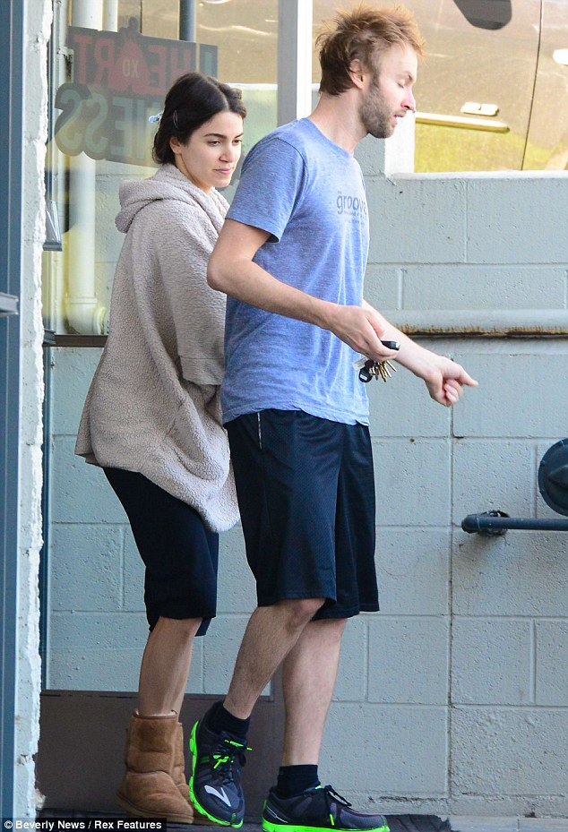 Gym bunnies: The Twilight actress sensibly opted for comfort over style as she hit her gym class, wearing a simple black v-neck T-shirt, navy jogging bottoms and a cream fluffy cover-up