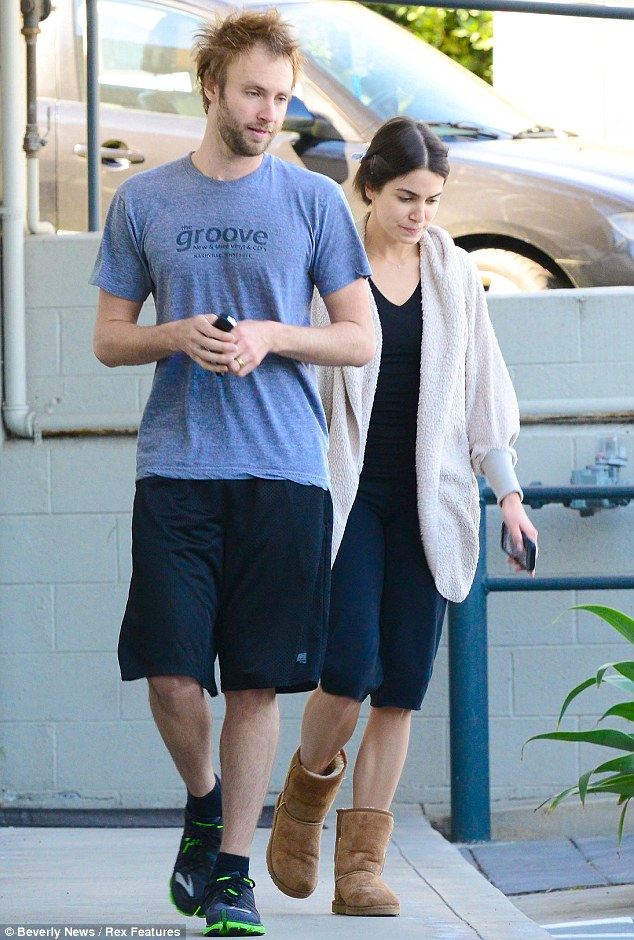 Make-up free: The 24-year-old actress showed off her naturally flawless skin as she headed out with her husband for the day