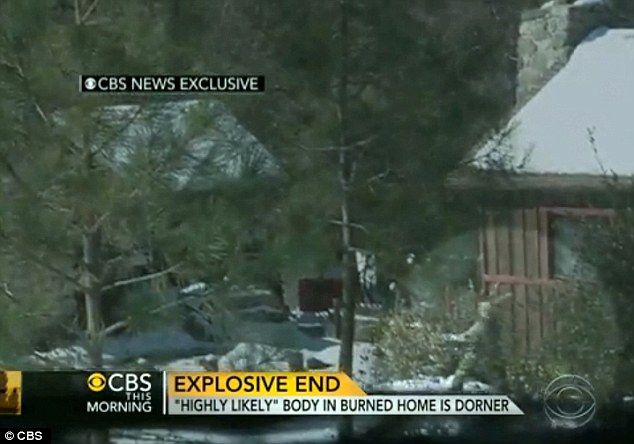 Counter attack: An officer is seen lobbing a gas grenade as others open fire on the cabin where Christopher Dorner barricaded himself