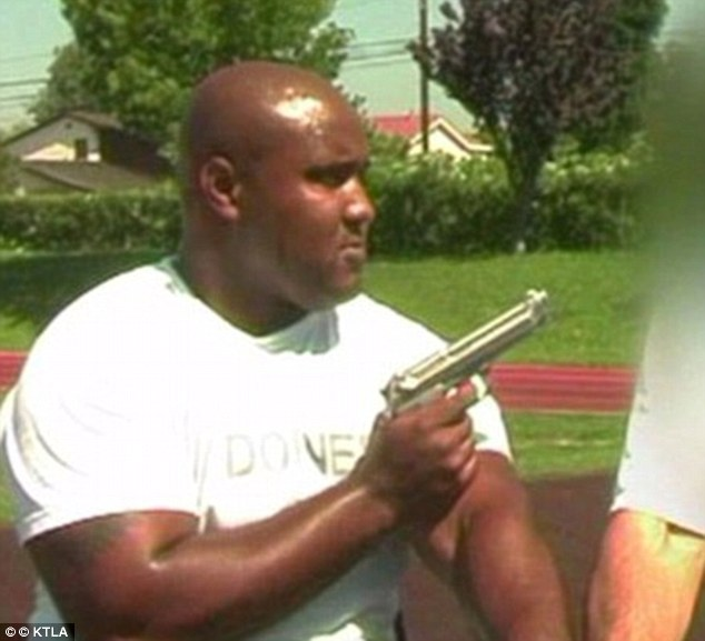 Testing: Christopher Dorner, seen here during LAPD training, is believed to have died in the cabin fire on Tuesday night