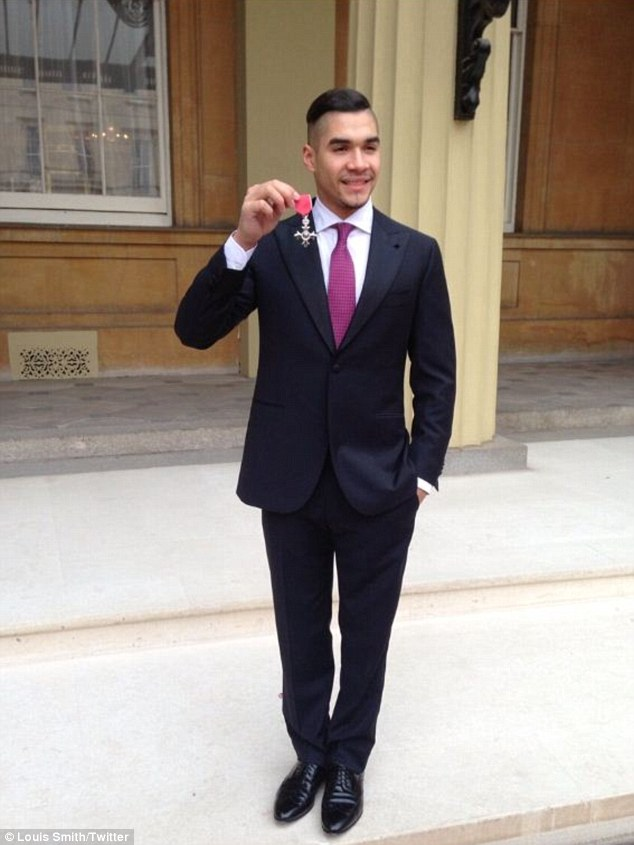 'Chilling with my MBE on the palace steps': Louis made sure to post a picture documenting his day to his Twitter