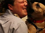 Planet Dog: Dogs and owners lock lips at ninth annual Valentine's Day Canine Kissing Contest