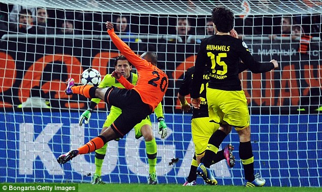 Cracker: Douglas Costa looked to have won the first leg for Shakhtar when he scored in the second half