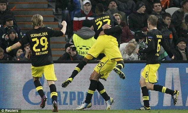 Game on: Borussia Dortmund celebrate after Mats Hummels' header earned them a draw in Ukraine