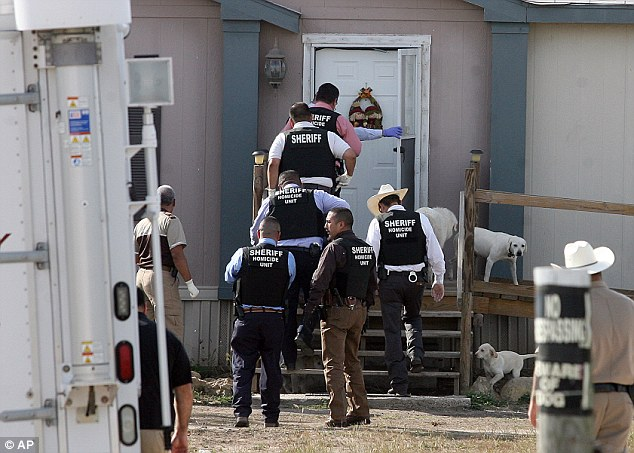 Hidalgo County sheriff's investigators enter the home of Thomas Matusiewicz while serving a warrant north of Edcouch-Elsa, Texas