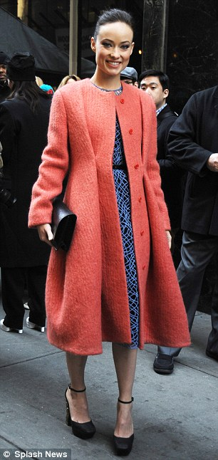 Fashionista: The Revlon hair spokesmodel paired her sleeveless belted frock with black studded heels, a matching clutch, and a chic coral-coloured coat