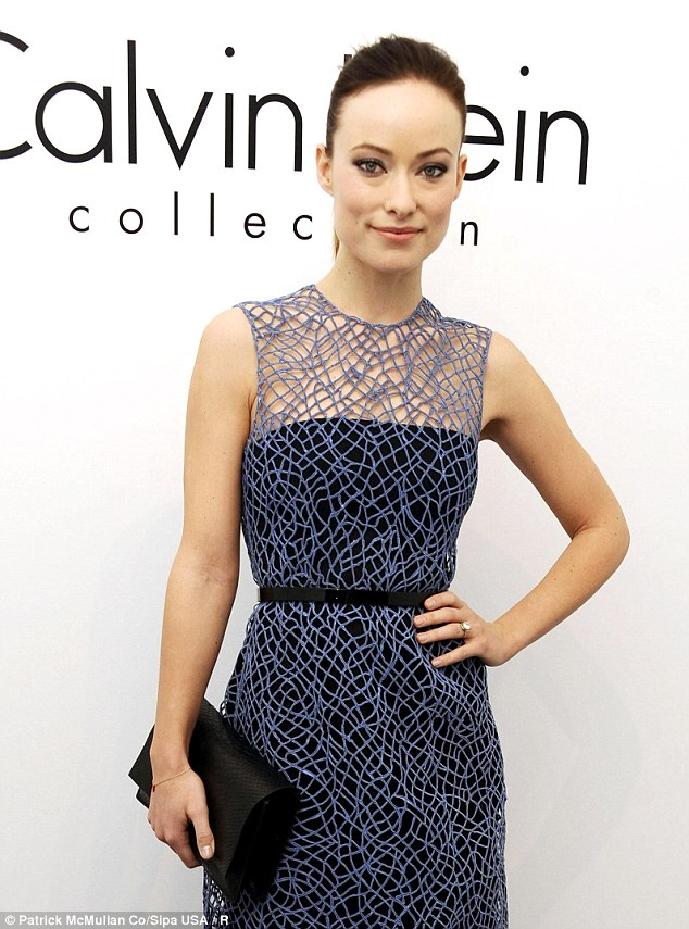 Nothing but net: Newly engaged Olivia Wilde donned a blue-netted cocktail dress to go along with her antique round-cut diamond sparkler at Calvin Klein's NYFW show Thursday
