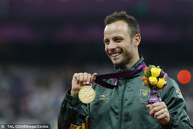Winner: Oscar Pistorius celebrates with his gold medal following the men's 400m win at London 2012