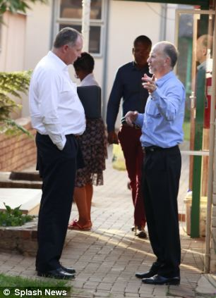 Family members of Oscar Pistorius were pictured outside the police station where he was being held