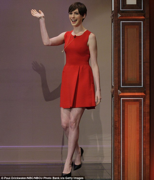 Red hot! Anne Hathaway dazzled in a scarlet skater dress as she made an appearance on The Tonight Show with Jay Leno on Wednesday