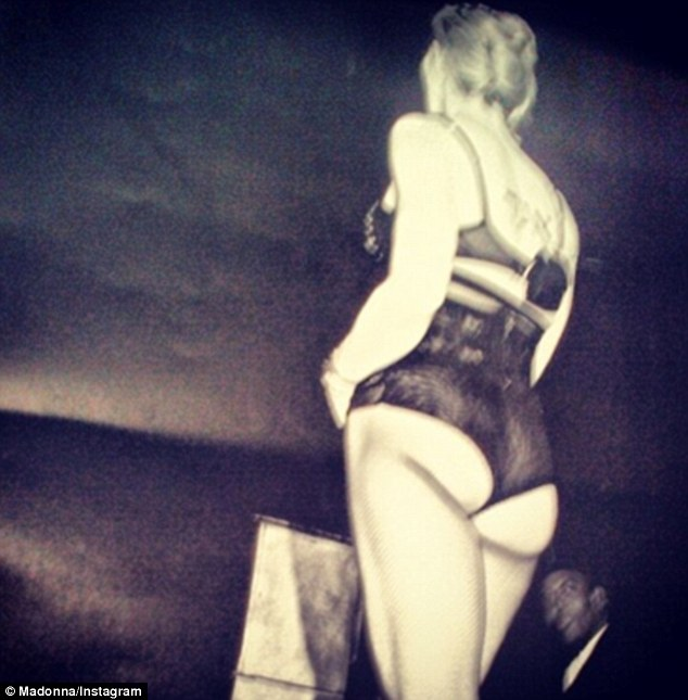 Racy behind shot: Madonna uses her Instagram account to post a picture of herself dressed in a risqué stage outfit on Wednesday