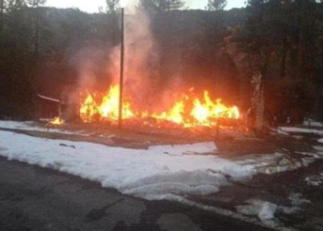Helpless: TV news chopper captured live images of the cabin burning down
