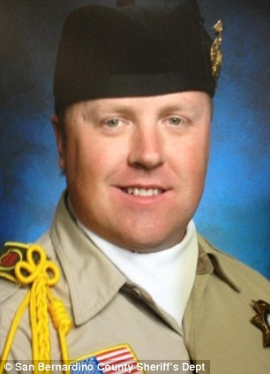 Killed: Detective Jeremiah MacKay, 35, was shot dead during the standoff with Dorner
