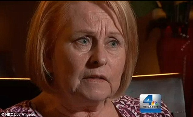 Devastated: Candy Martin said she sobbed as she watched her family's vacation home burn to the ground on live television