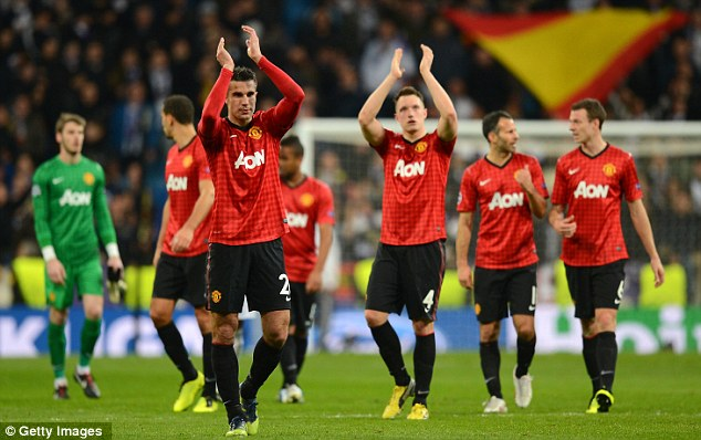United front: Sir Alex Ferguson's players are chasing a Premier League, Champions League and FA Cup treble