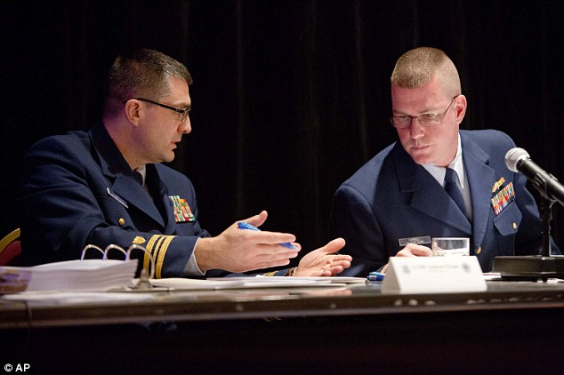 LCDR Legal Advisor Andrew Grant of the US Coast Guard, (left), and Commander Kevin Carroll, Chief of Inspections and Investigations, talk to each other while Chief mate of the HMS Bounty, John Svendsen testifies