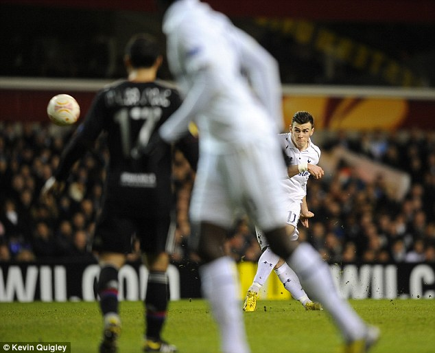 Bend it like Bale: The Spurs forward strikes his free kick goalwards