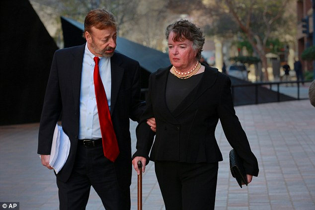 Former San Diego mayor Maureen O'Connor, walks to federal court in San Diego, today with her attorney Eugene Iredale