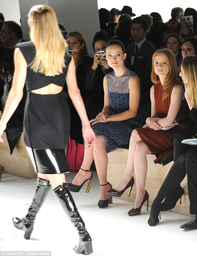 New Yorker: With her brunette locks slicked back into a ponytail, Olivia surveyed Calvin Klein's fall fashion line at Mercedes-Benz Fashion Week