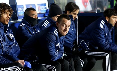 Waiting game: John Terry on the bench in Prague
