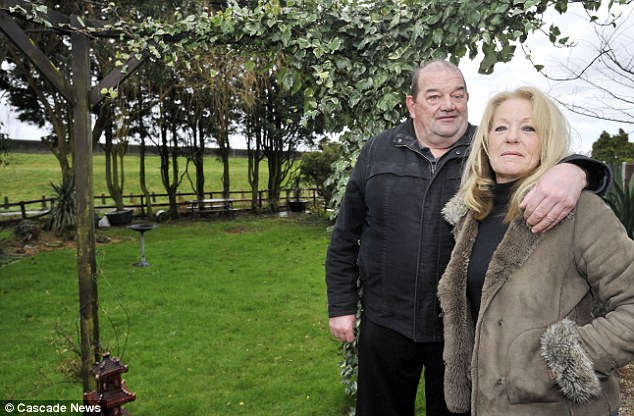 Wanting reimbursement for the work they've done: Bill and Jean Graham in their Beck Road garden